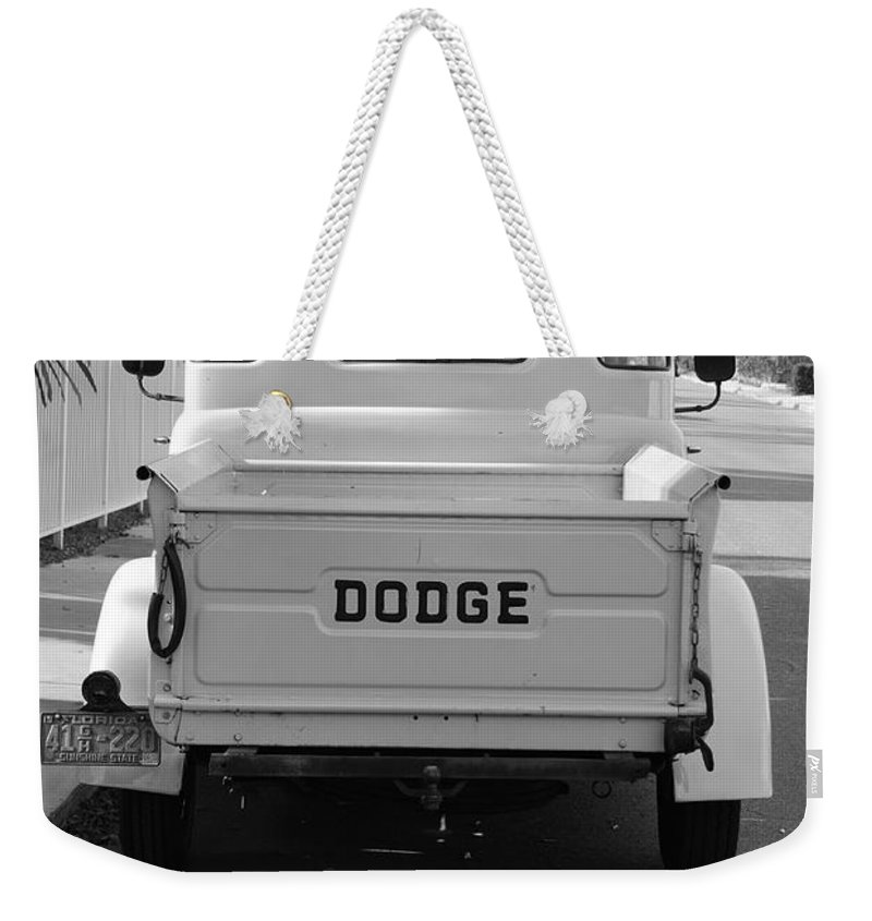 Black And White Weekender Tote Bag featuring the photograph The Old Dodge by Rob Hans