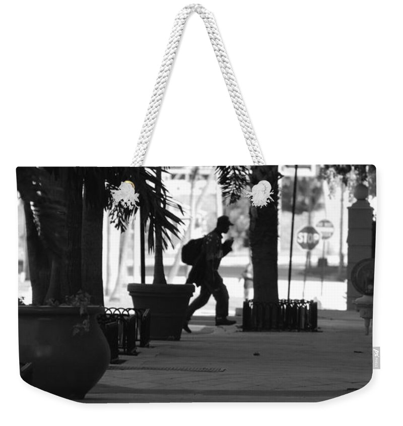 Street Scene Weekender Tote Bag featuring the photograph The Post Man by Rob Hans