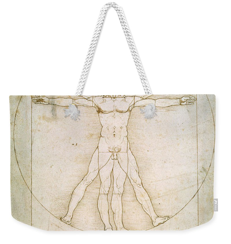 The Weekender Tote Bag featuring the drawing The Proportions Of The Human Figure by Leonardo da Vinci