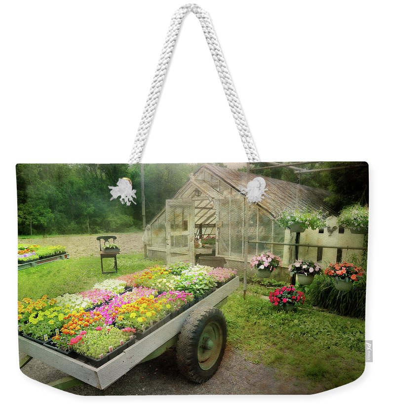 Garden Center Weekender Tote Bag featuring the photograph The Tractor Pull 1 by Diana Angstadt