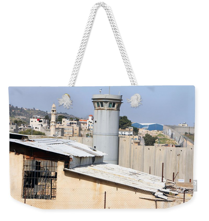 Watch Weekender Tote Bag featuring the photograph The Watch by Munir Alawi
