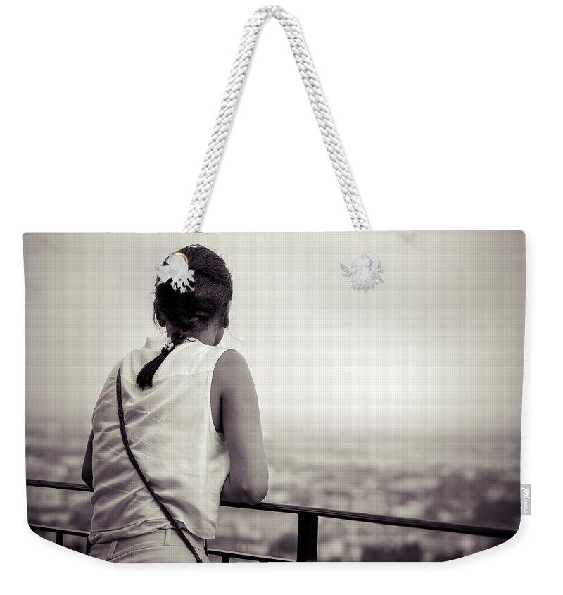 Alfio Finocchiaro Weekender Tote Bag featuring the photograph Thoughtful Women by Alfio Finocchiaro