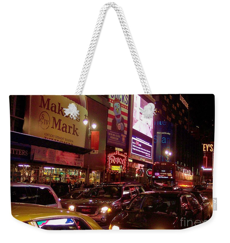 New York Weekender Tote Bag featuring the photograph Times Square Night by Debbi Granruth