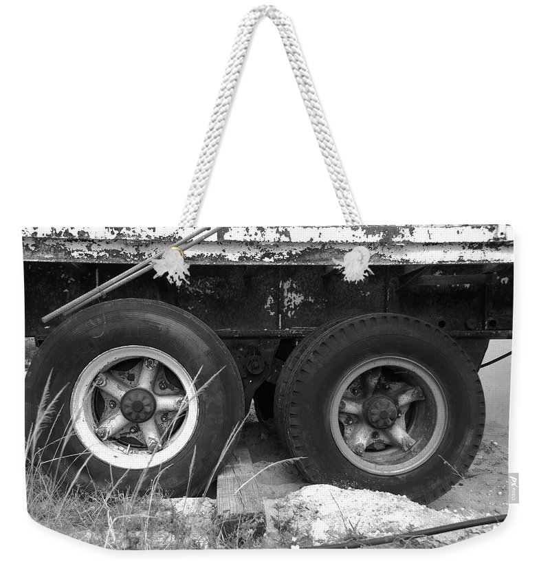 Black And White Weekender Tote Bag featuring the photograph Truck Tires by Rob Hans