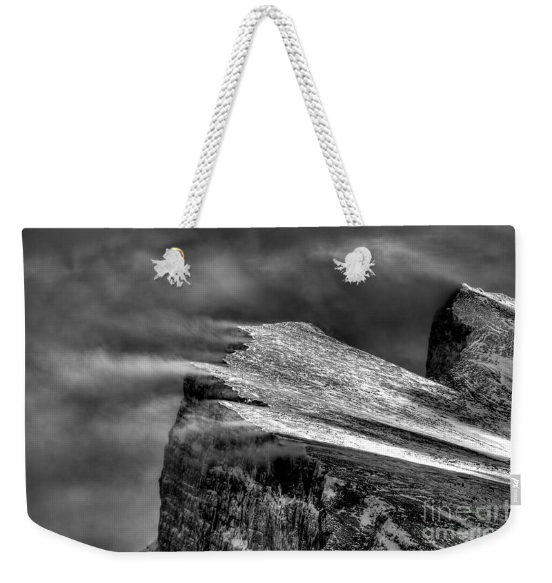 Black And White Weekender Tote Bag featuring the photograph Rumbling Rundle by James Anderson