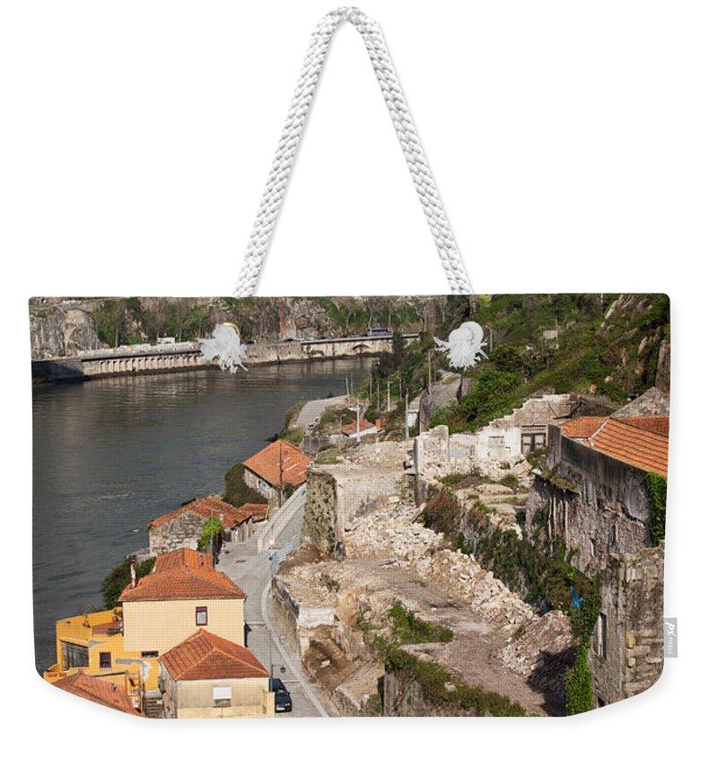 Bridge Weekender Tote Bag featuring the photograph Vila Nova De Gaia And Porto In Portugal by Artur Bogacki