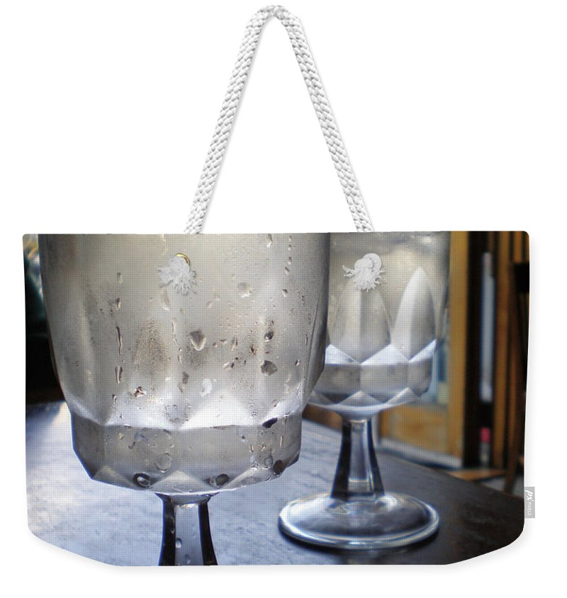 Weekender Tote Bag featuring the photograph Water Glasses Sweating by Iris Posner
