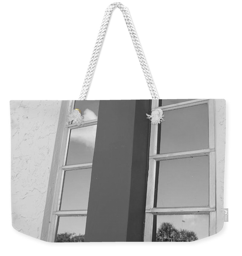 Black And White Weekender Tote Bag featuring the photograph Window T Glass by Rob Hans