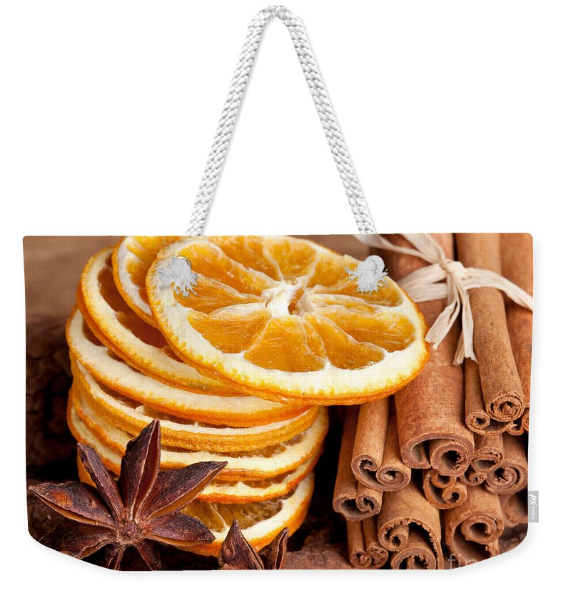 Cinnamon Weekender Tote Bag featuring the photograph Winter Spices by Nailia Schwarz