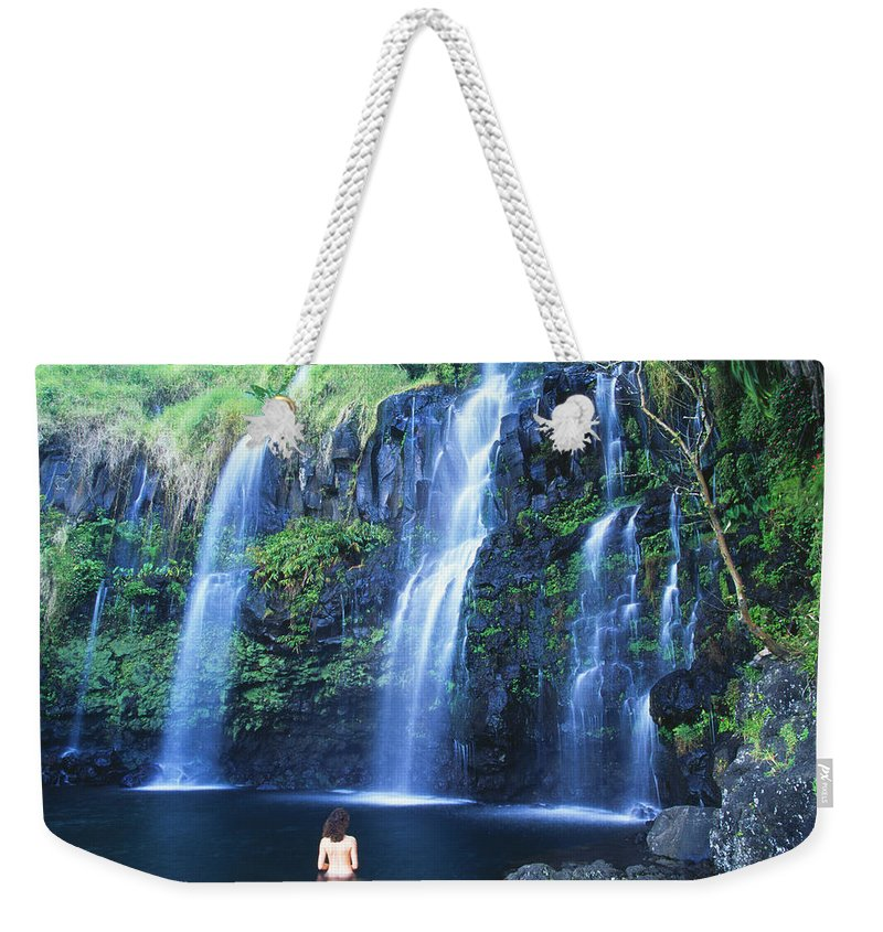 Base Weekender Tote Bag featuring the photograph Woman At Waterfall by Dave Fleetham - Printscapes