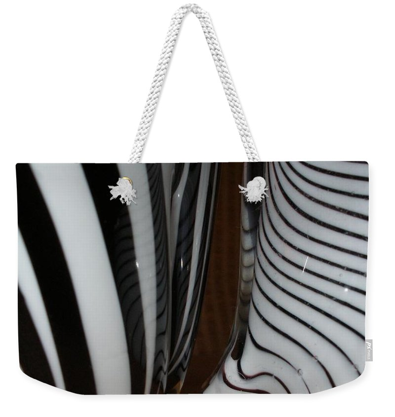 Blac Weekender Tote Bag featuring the photograph Zebra Glass by Maria Bonnier-Perez