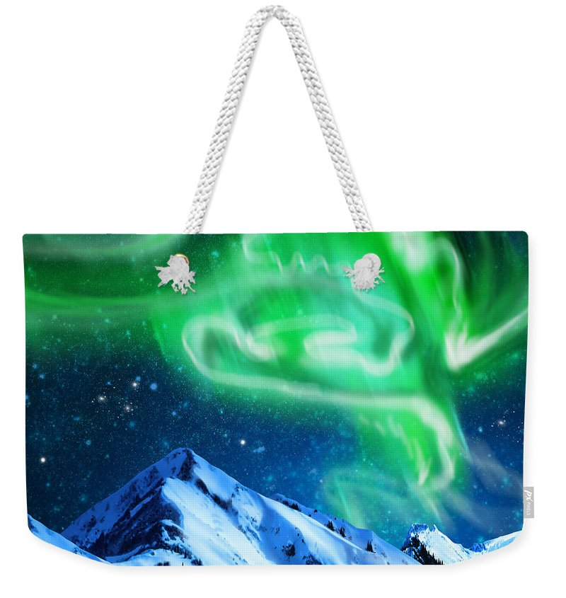 Above Weekender Tote Bag featuring the photograph Aurora Borealis by Setsiri Silapasuwanchai