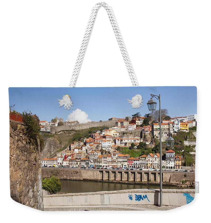 Porto Weekender Tote Bag featuring the photograph City Of Porto In Portugal by Artur Bogacki