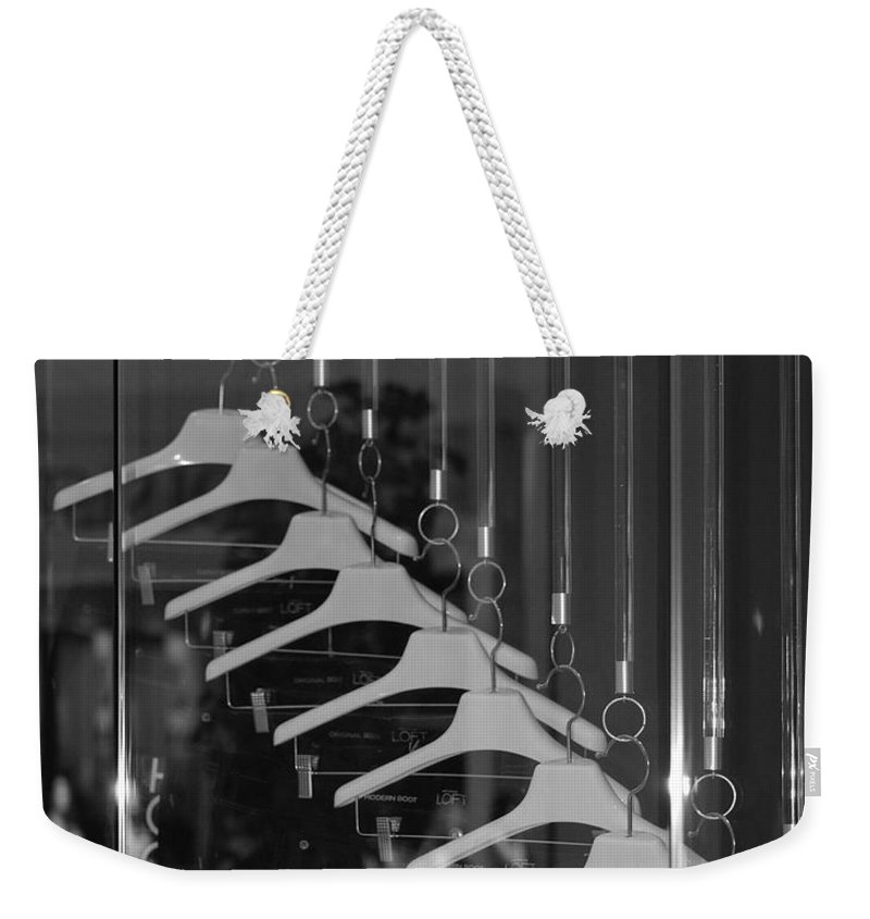 Hangers Weekender Tote Bag featuring the photograph 10 Hangers In Black And White by Rob Hans