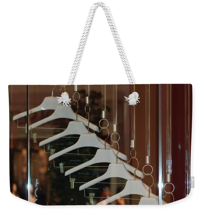 Hangers Weekender Tote Bag featuring the photograph 10 Hangers by Rob Hans