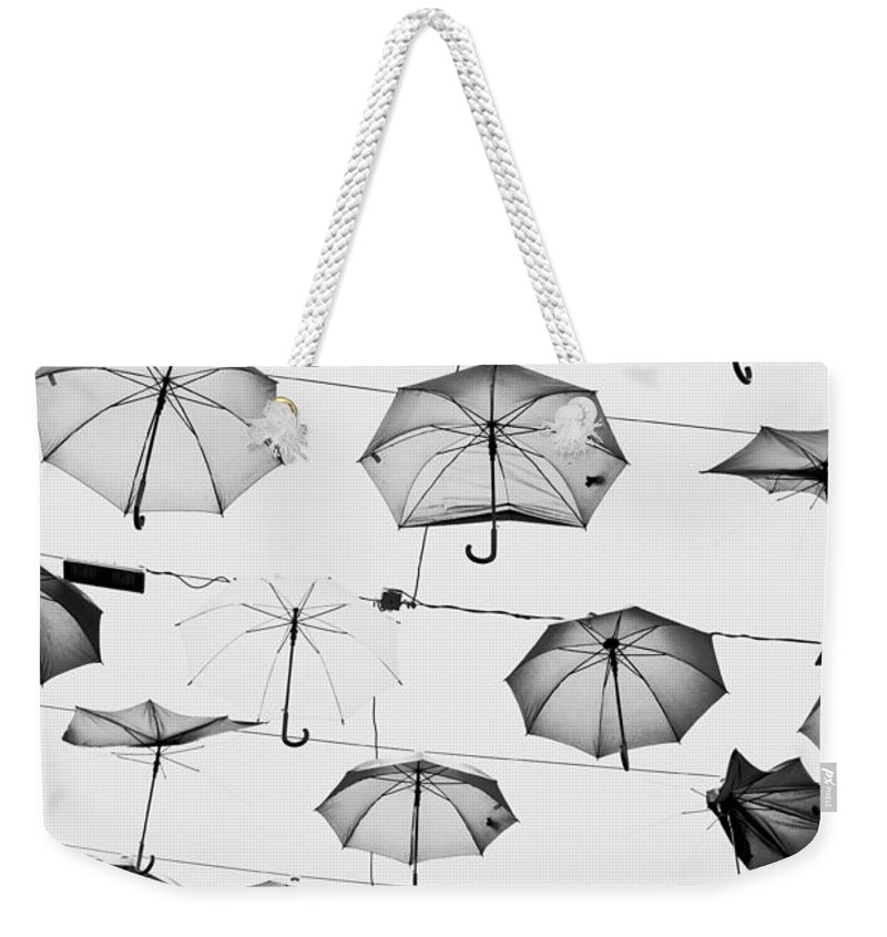 Art Weekender Tote Bag featuring the photograph Umbrellas by Tom Gowanlock