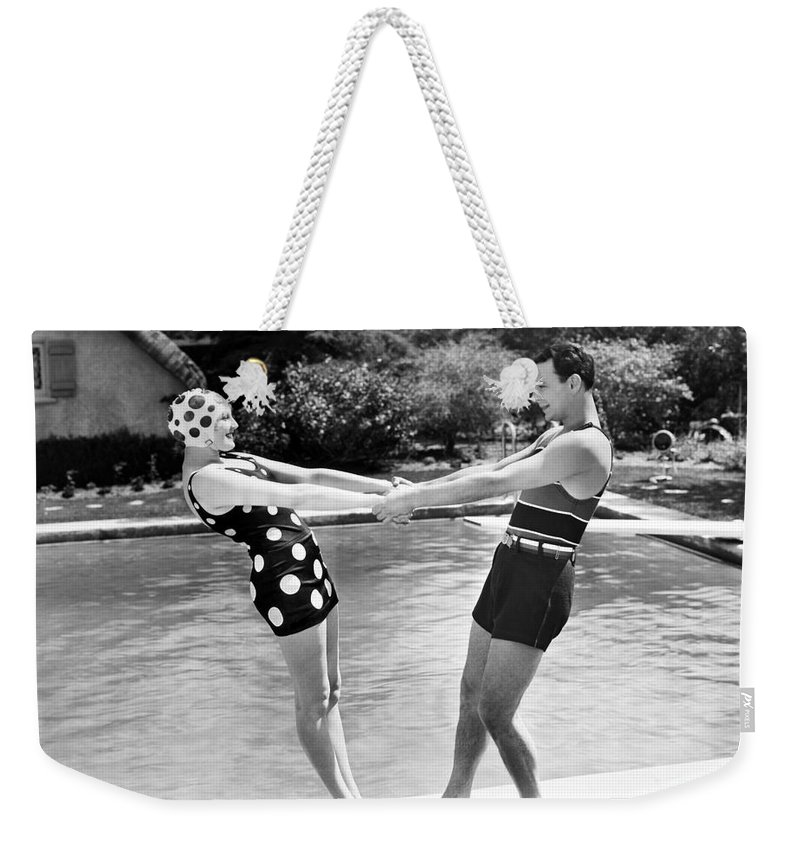-one Man One Woman- Weekender Tote Bag featuring the photograph Silent Still: Man & Woman by Granger