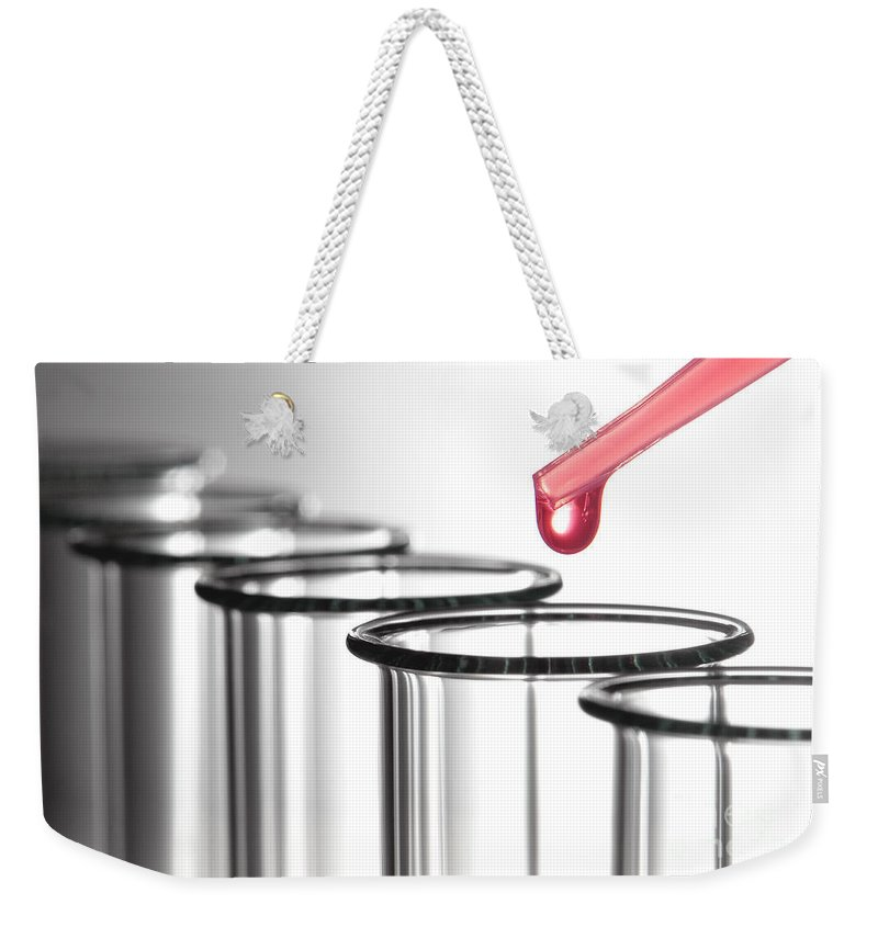 Above Weekender Tote Bag featuring the photograph Laboratory Experiment In Science Research Lab by Olivier Le Queinec