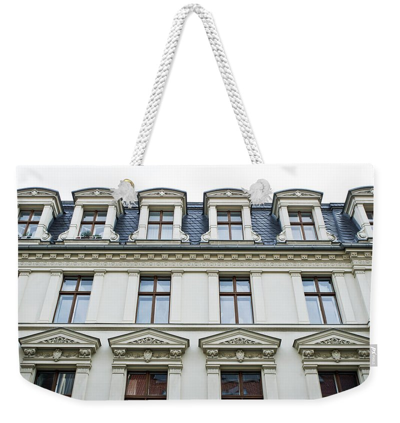 Apartment Weekender Tote Bag featuring the photograph Apartment Building by Tom Gowanlock