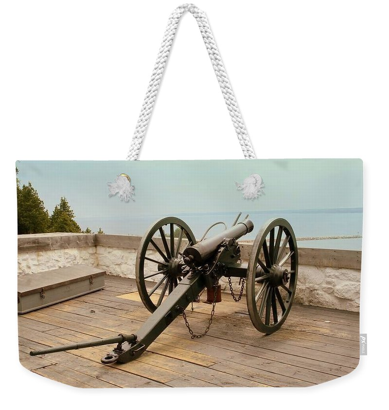 1841 Weekender Tote Bag featuring the photograph 1841 Model Six Pounder Cannon At Fort Mackinac by Anita Hiltz
