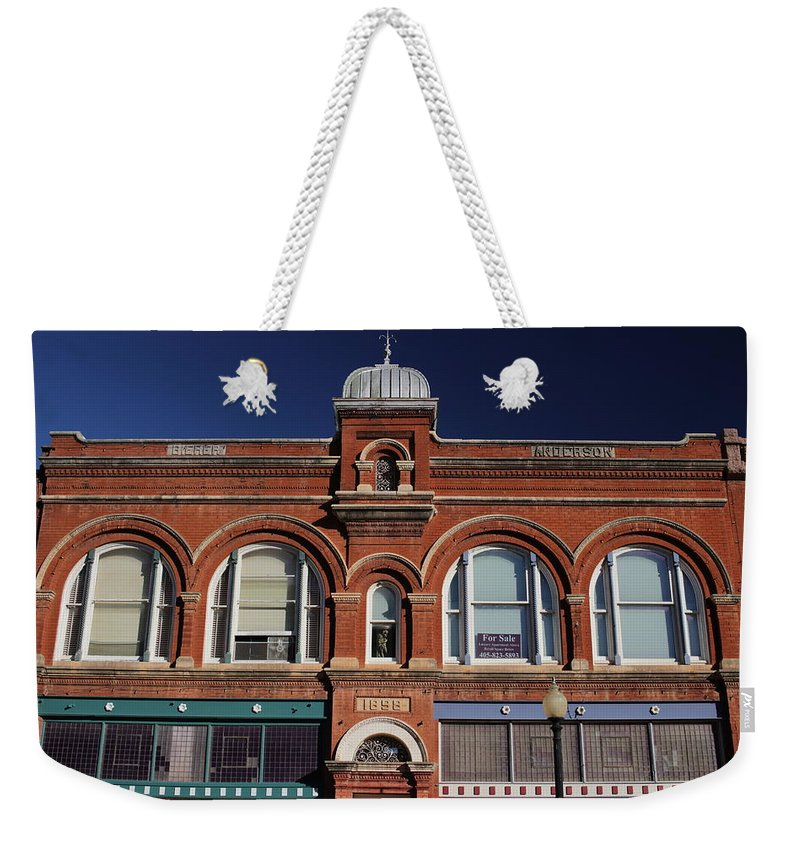 Guthrie Weekender Tote Bag featuring the photograph 1898 Building Front by Buck Buchanan
