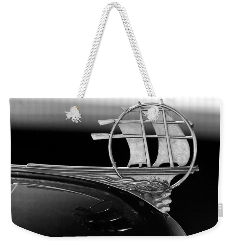 Transportation Weekender Tote Bag featuring the photograph 1934 Plymouth Hood Ornament Black And White by Jill Reger