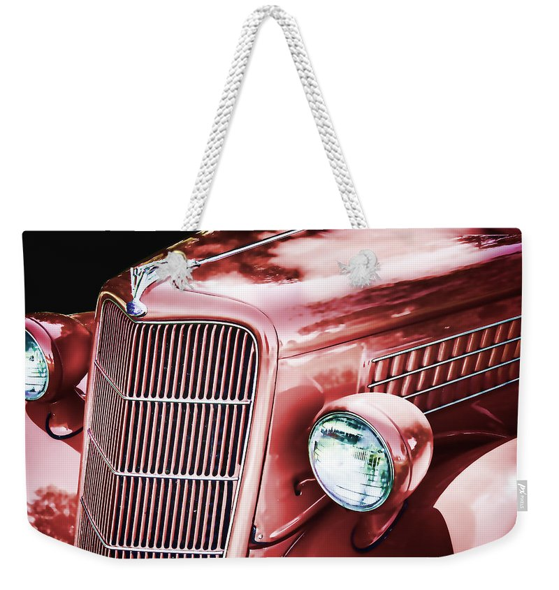 1935 Weekender Tote Bag featuring the photograph 1935 Ford Sedan Hood by Nick Gray