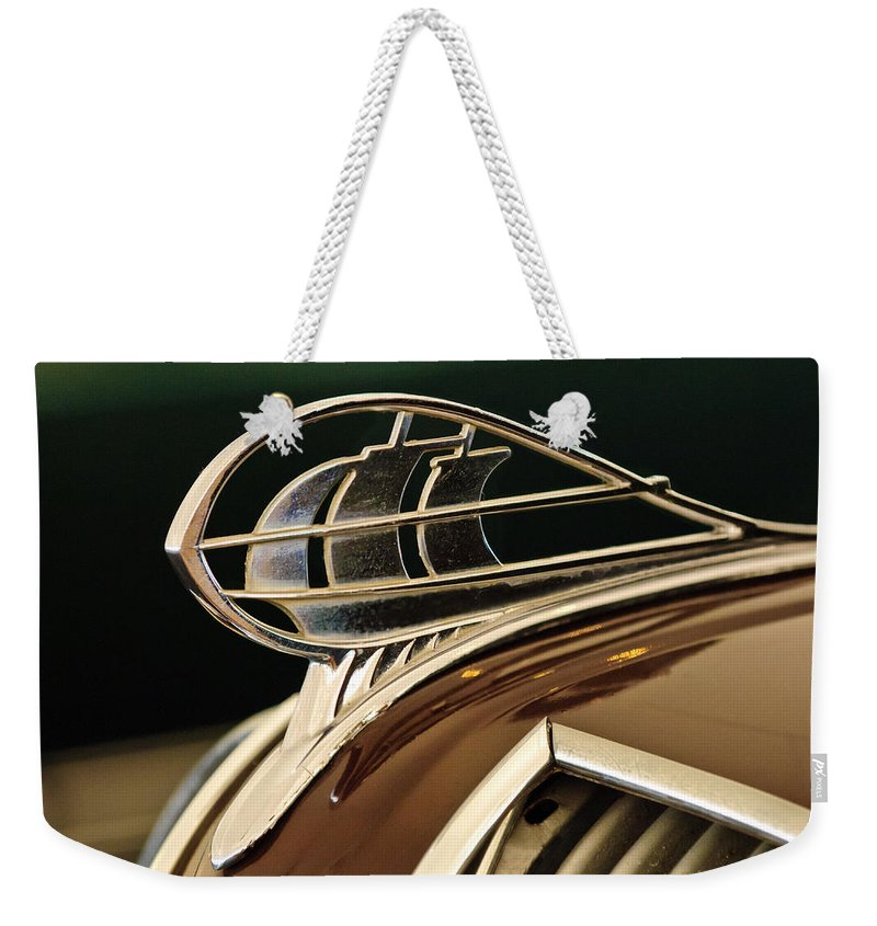 1936 Plymouth Sedan Weekender Tote Bag featuring the photograph 1936 Plymouth Sedan Hood Ornament by Jill Reger
