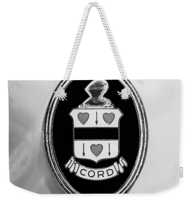 1937 Cord 812 Sc Phaeton Emblem Weekender Tote Bag featuring the photograph 1937 Cord 812 Sc Phaeton Emblem -1203bw2 by Jill Reger