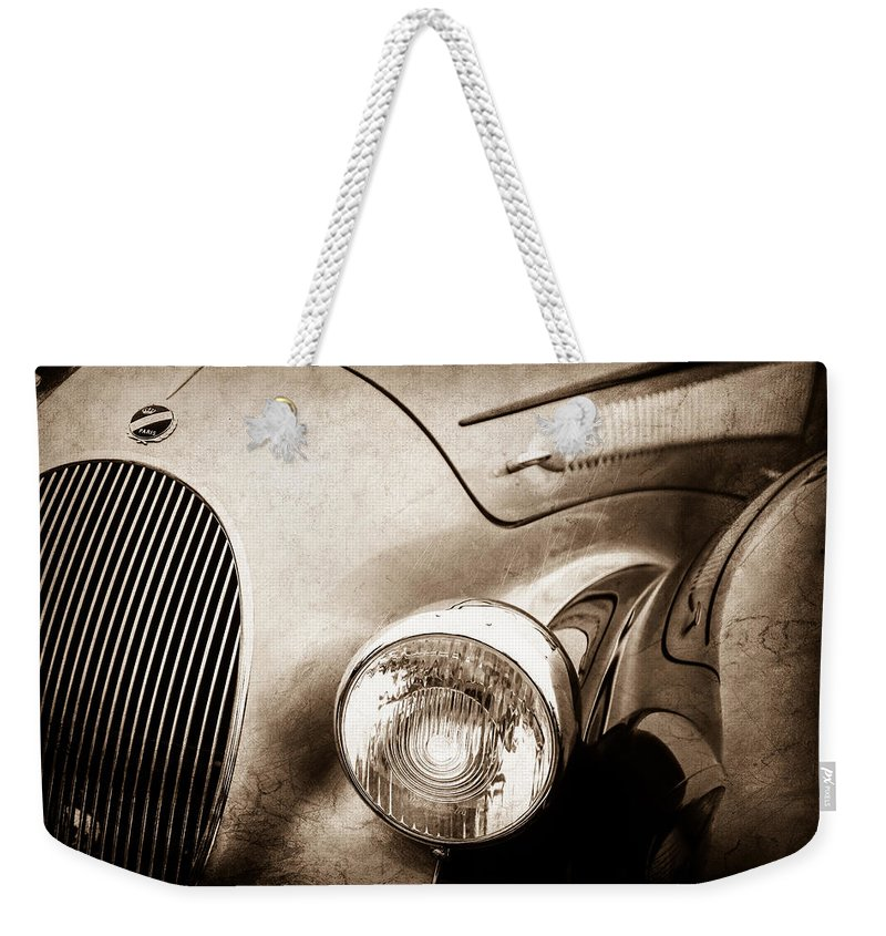 1938 Talbot-lago 150c Ss Figoni And Falaschi Cabriolet Headlight Weekender Tote Bag featuring the photograph 1938 Talbot-lago 150c Ss Figoni And Falaschi Cabriolet Headlight - Emblem -1554s by Jill Reger