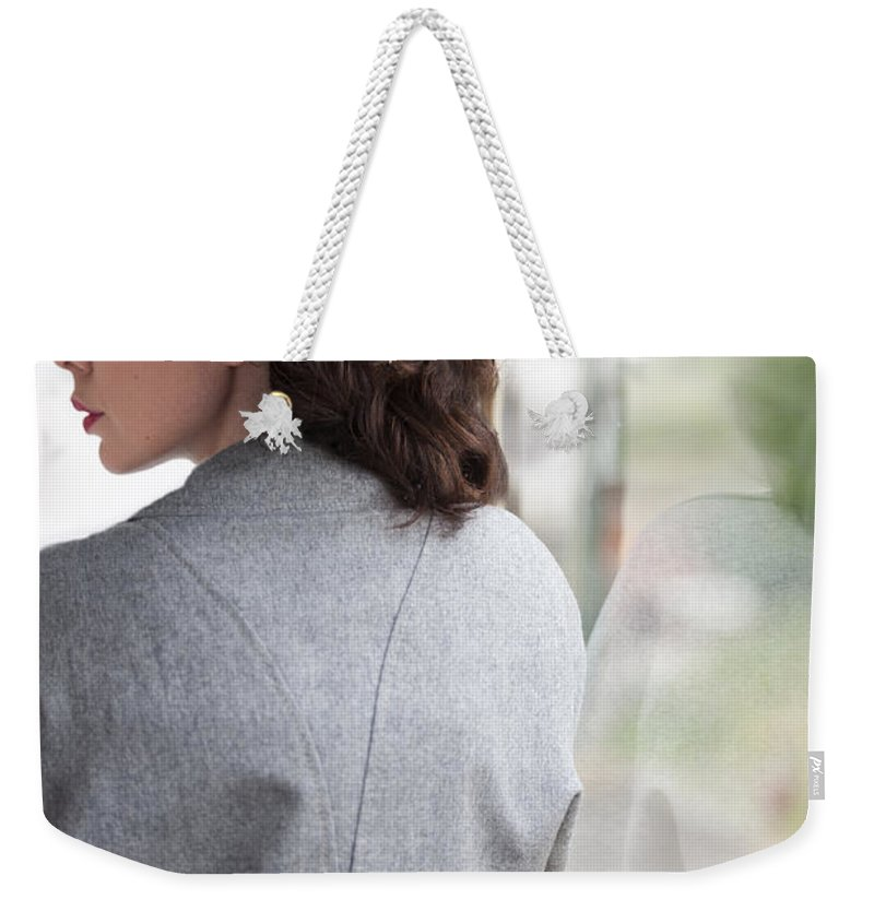 Woman Weekender Tote Bag featuring the photograph 1940s Woman Making A Journey On Public Transport by Lee Avison