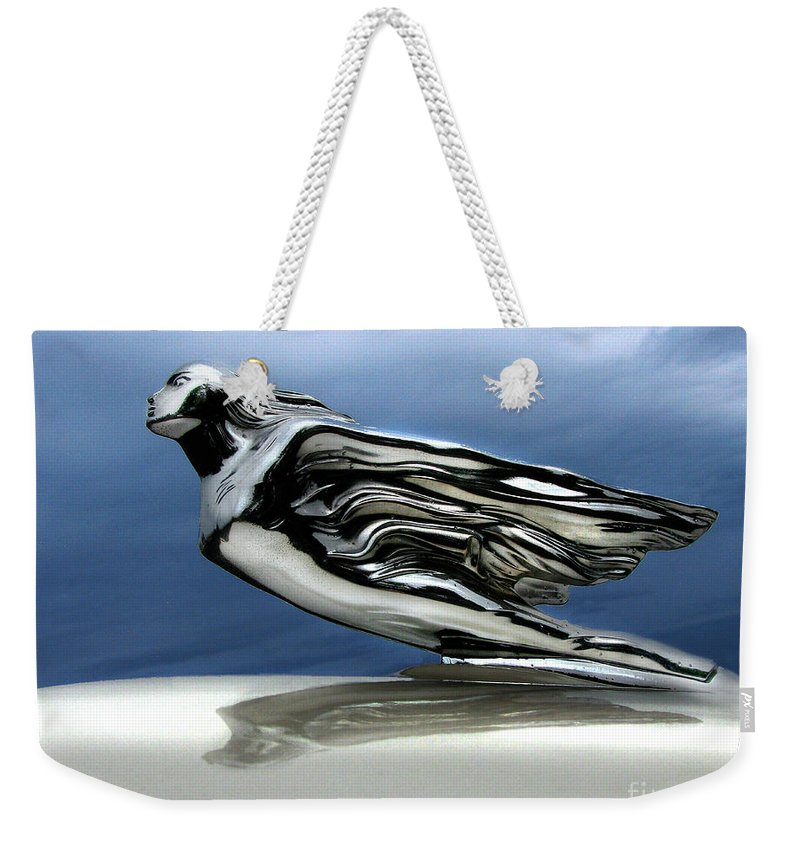 1941 Cadillac Weekender Tote Bag featuring the photograph 1941 Cadillac Emblem Abstract by Peter Piatt
