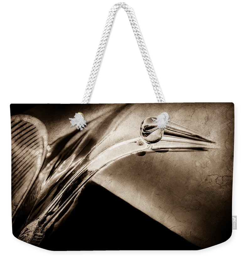 1941 Lincoln Contitnental Convertible Hood Ornament Weekender Tote Bag featuring the photograph 1941 Lincoln Contitnental Convertible Hood Ornament - Grille Emblem -0438s by Jill Reger