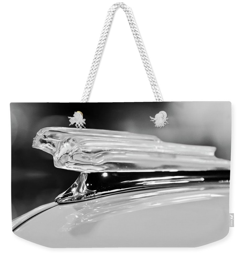 1942 Chevrolet Fleetline Weekender Tote Bag featuring the photograph 1942 Chevrolet Fleetline Hood Ornament 2 by Jill Reger