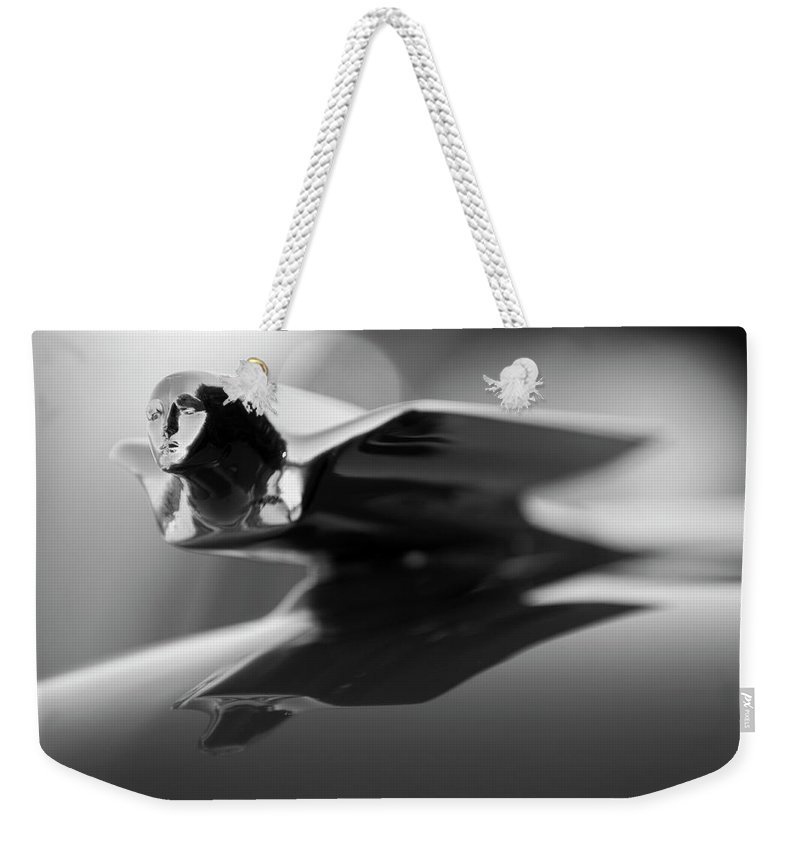 1947 Cadillac Weekender Tote Bag featuring the photograph 1947 Cadillac Hood Ornament 2 by Jill Reger