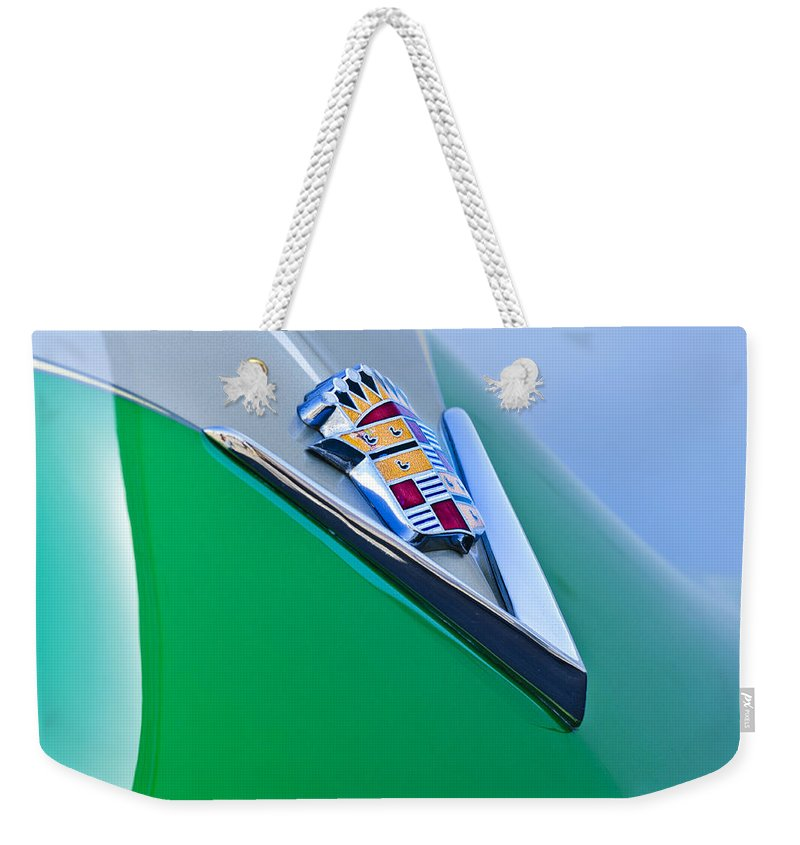 1948 Cadillac Weekender Tote Bag featuring the photograph 1948 Cadillac Emblem by Jill Reger