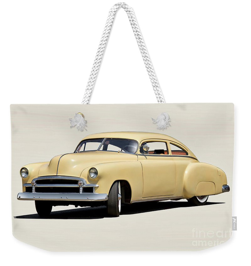 Auto Weekender Tote Bag featuring the photograph 1949 Chevrolet Custom Fleetline Sedan II by Dave Koontz