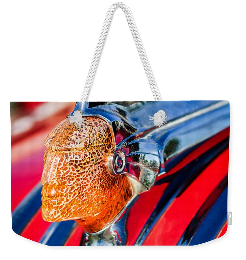 1951 Pontiac Chief Hood Ornament Weekender Tote Bag featuring the photograph 1951 Pontiac Chief Hood Ornament by Jill Reger