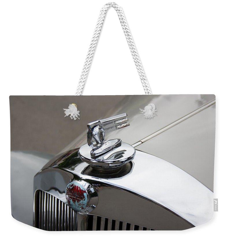 52 Weekender Tote Bag featuring the photograph 1952 Triumph Renown Limosine Radiator Cap by Robert Kinser