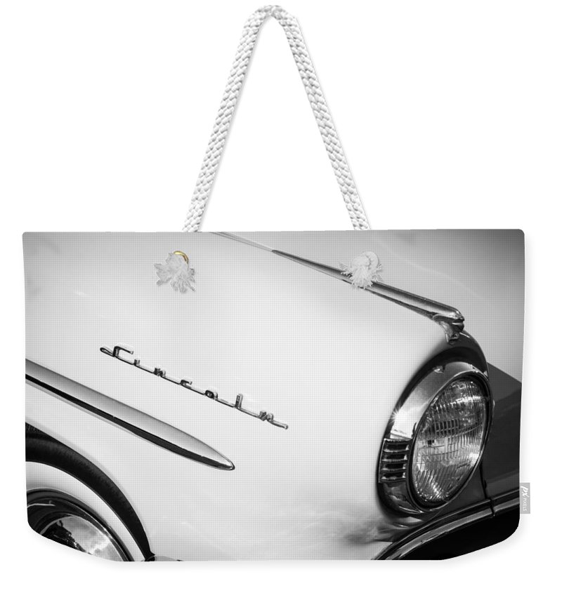 1954 Lincoln Capri Head Light Emblem Weekender Tote Bag featuring the photograph 1954 Lincoln Capri Head Light Emblem -0144bw by Jill Reger
