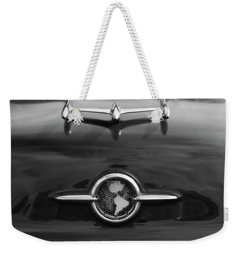 1955 Oldsmobile Holiday 88 Weekender Tote Bag featuring the photograph 1955 Oldsmobile Holiday 88 Hood Ornament 2 by Jill Reger