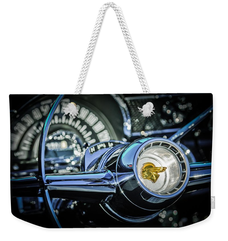 1955 Pontiac Star Chief Steering Wheel Emblem Weekender Tote Bag featuring the photograph 1955 Pontiac Star Chief Steering Wheel Emblem -0103c by Jill Reger