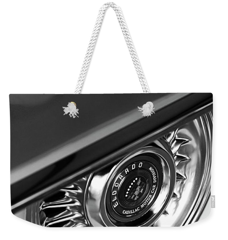Car Weekender Tote Bag featuring the photograph 1956 Cadillac Eldorado Wheel Black And White by Jill Reger