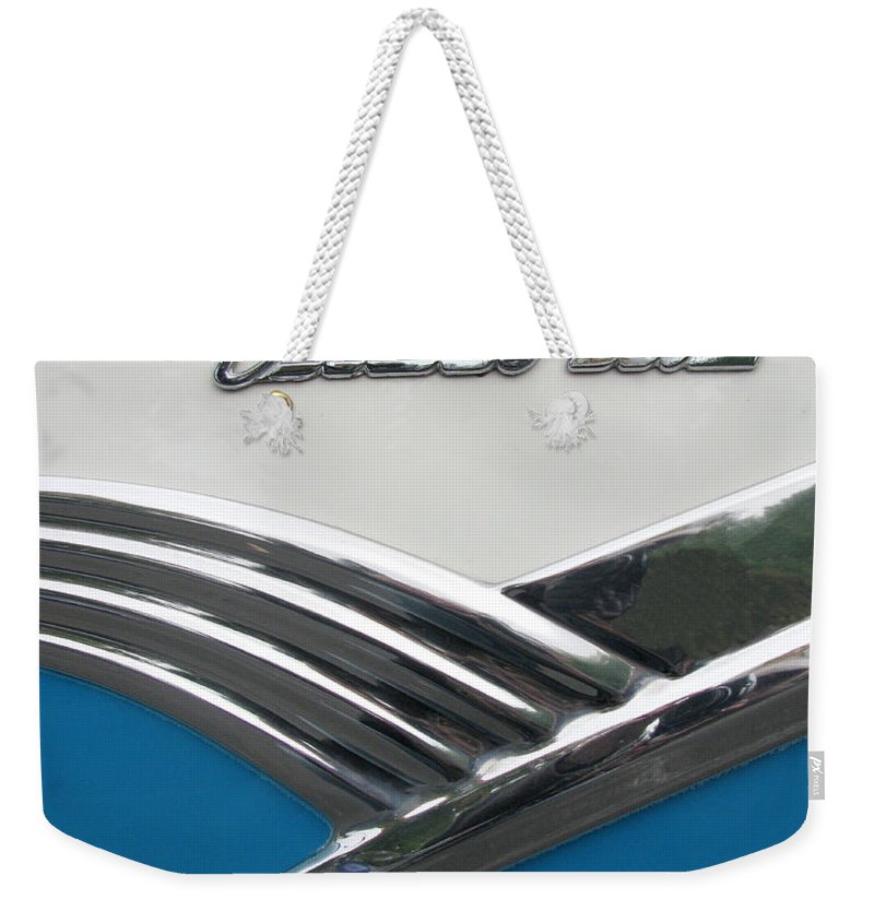 1956 Ford Victoria Two Door Hardtop Weekender Tote Bag featuring the photograph 1956 Ford Peacock Blue by Peter Piatt