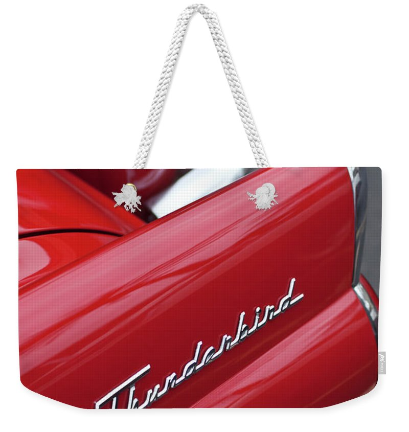1956 Ford Thunderbird Weekender Tote Bag featuring the photograph 1956 Ford Thunderbird Taillight Emblem 2 by Jill Reger