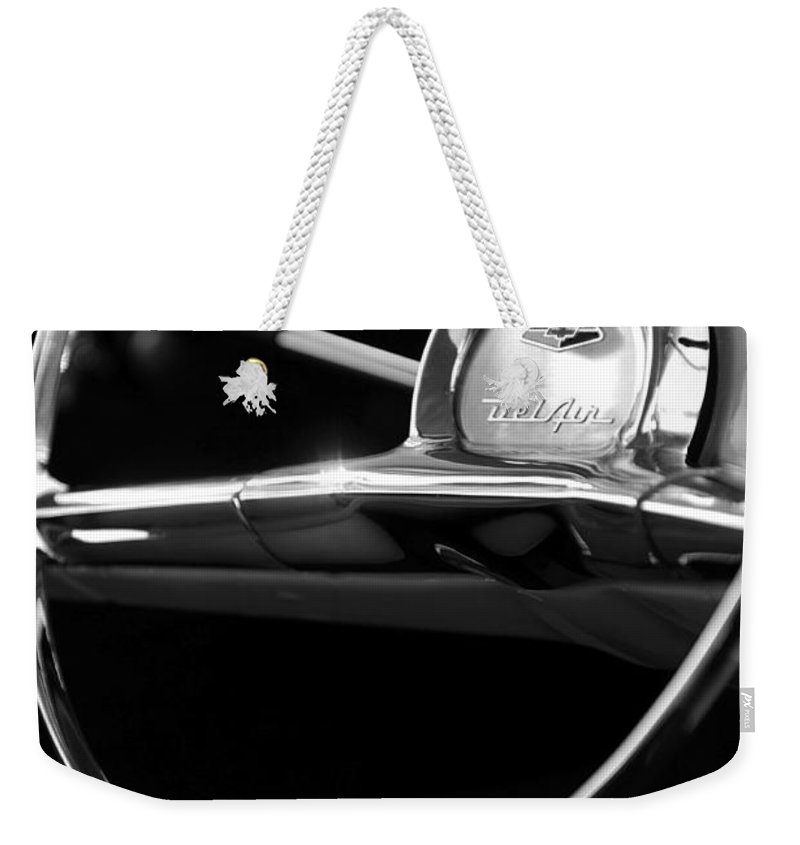 Transportation Weekender Tote Bag featuring the photograph 1957 Chevrolet Belair Steering Wheel Black And White by Jill Reger