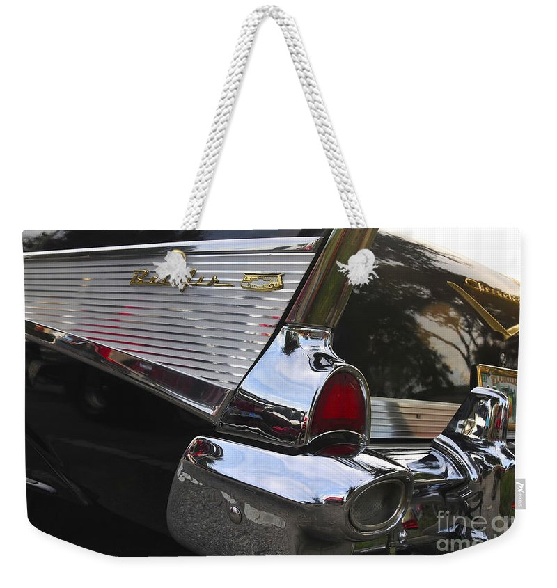 1957.chevy Weekender Tote Bag featuring the photograph 1957 Chevy Bel-air by David Lee Thompson