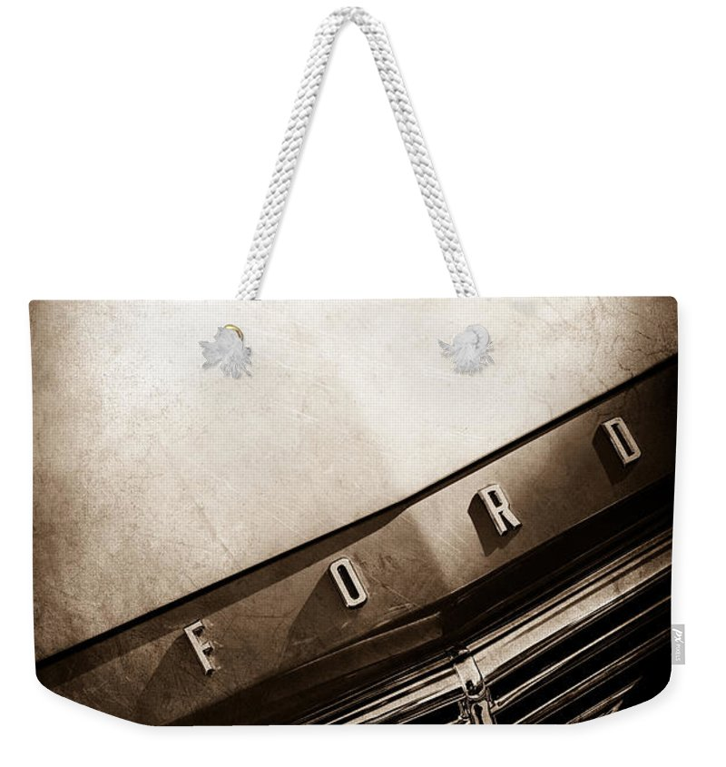 1957 Ford Custom 300 Series Ranchero Hood Ornament Weekender Tote Bag featuring the photograph 1957 Ford Custom 300 Series Ranchero Hood Ornament - Emblem -0477s by Jill Reger