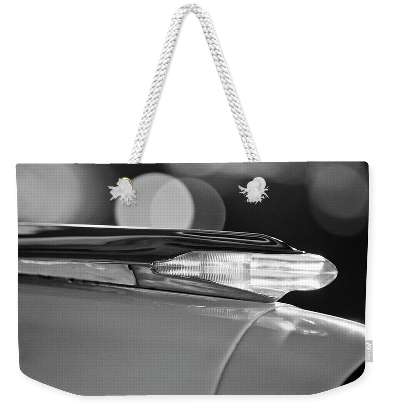 1957 Pontiac Bonneville Weekender Tote Bag featuring the photograph 1957 Pontiac Bonneville Hood Ornament - Fender Spear 2 by Jill Reger