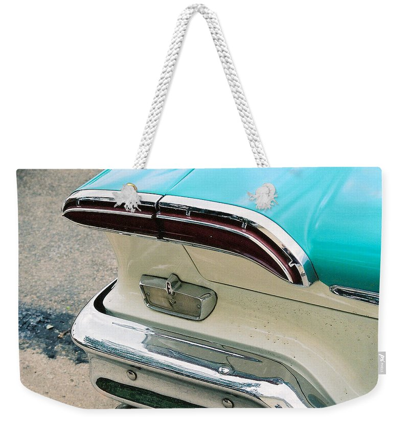1958 Edsel Weekender Tote Bag featuring the photograph 1958 Edsel Pacer Tail Light by Lauri Novak
